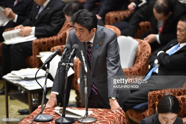 Japan's Prime Minister Shinzo Abe answers questions during a budget committee morning session of the House of Representatives at the Diet in Tokyo on...