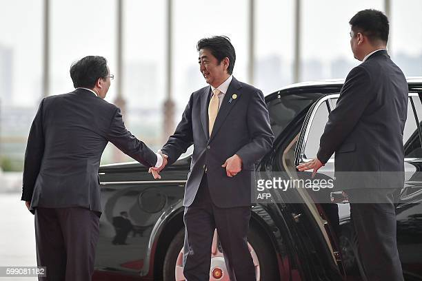 Japan's Prime Minister Shinzo Abe arrives at the Hangzhou International Expo Center to attend the G20 Summit in Hangzhou on September 4, 2016. World...