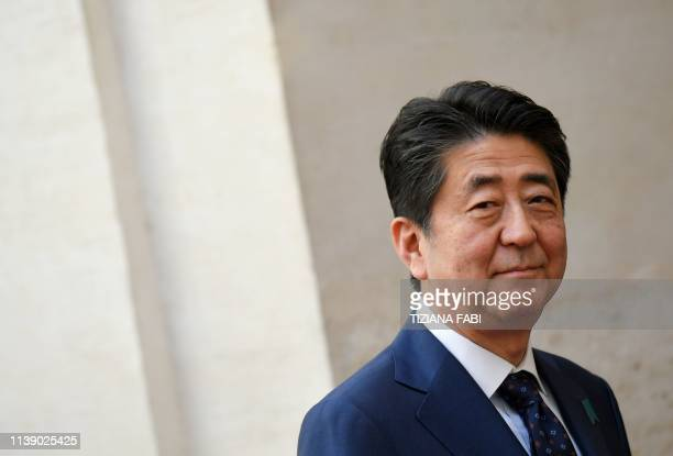 Japan's Prime Minister Shinzo Abe arrives at the Palazzo Chigi to attend a meeting with Italy's Prime Minister, on April 24, 2019 in Rome, during a...