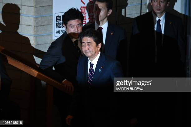 Japan's Prime Minister Shinzo Abe arrives to vote during the ruling Liberal Democratic Party leadership election at the party's headquarters in Tokyo...