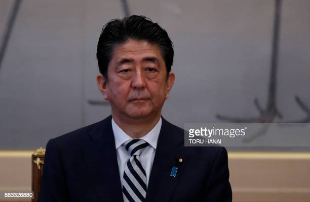 Japan's Prime Minister Shinzo Abe attends a meeting of the Imperial Household Council to discuss the timeline for the abdication of Japan's Emperor...