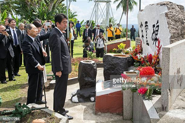 Japan's Prime Minister Shinzo Abe attends a memorial at Wewak in Papua New Guinea on July 11 2014 Abe is visiting New Zealand Australia and Papua New...