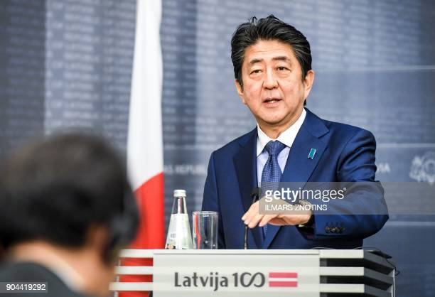 Japan's Prime Minister Shinzo Abe attends a press conference with his Latvian counterpart after their meeting in Riga Latvia on January 13 2018...