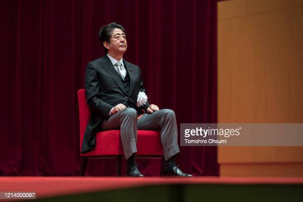 Japan's Prime Minister Shinzo Abe attends the graduation ceremony of the National Defense Academy on March 22, 2020 in Yokosuka, Japan. 508 students...