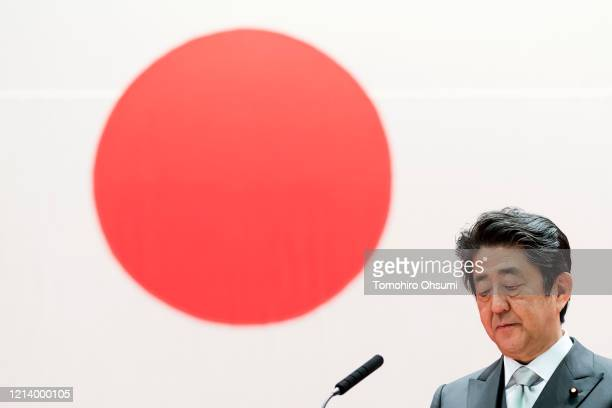 Japan's Prime Minister Shinzo Abe attends the graduation ceremony of the National Defense Academy on March 22 2020 in Yokosuka Japan 508 students...