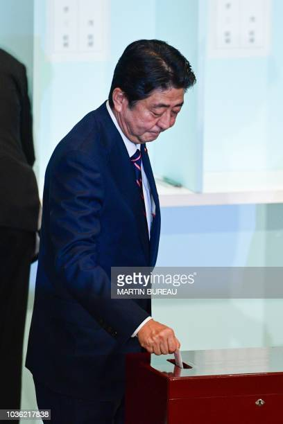 Japan's Prime Minister Shinzo Abe casts his ballot during the ruling Liberal Democratic Party leadership election at the party's headquarters in...