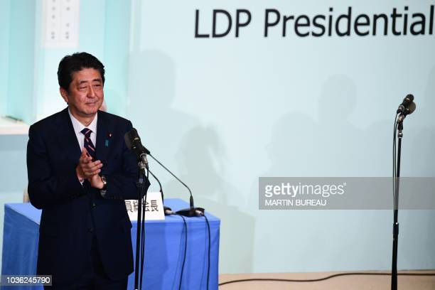 Japan's Prime Minister Shinzo Abe delivers a speech during the ruling liberal Democratic Party leadership election at the party's headquarters in...
