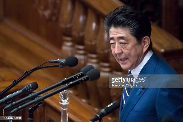 Japan's Prime Minister Shinzo Abe delivers his policy speech at the lower house of the parliament on January 20 2020 in Tokyo Japan The Japanese Diet...