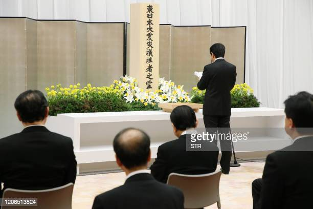 Japan's Prime Minister Shinzo Abe delivers words of mourning during the 9th memorial service for victims of the 2011 earthquake and tsunami disaster...