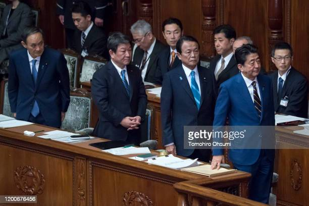 Japan's Prime Minister Shinzo Abe Deputy Prime Minister and Finance Minister Taro Aso Foreign Minister Toshimitsu Motegi and Chief Cabinet Secretary...