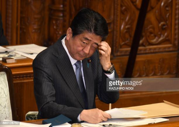 Japan's Prime Minister Shinzo Abe gestures after his answer questions to an opposition party member during the plenary session of the upper house of...