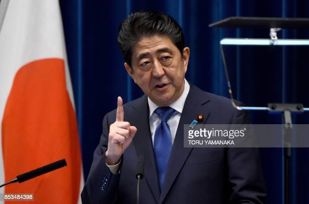 Japan's Prime Minister Shinzo Abe gestures as he speaks during a press conference at his official residence in Tokyo on September 25, 2017. - Abe...