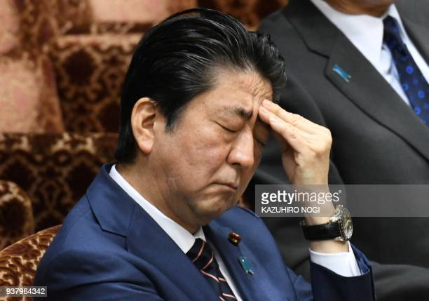 TOPSHOT Japan's Prime Minister Shinzo Abe gestures during a session of the upper house budgetary committee at parliament in Tokyo on March 26 2018...