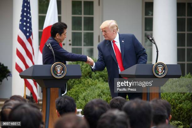 Japan's Prime Minister Shinzo Abe holds a joint press conference with US President Donald Trump after a bilateral meeting at the White House