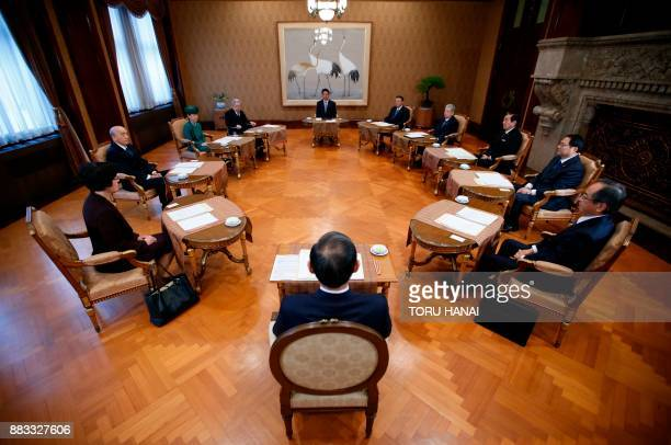 TOPSHOT Japan's Prime Minister Shinzo Abe House of Representatives speaker Tadamori Oshima House of Councillors speaker Chuichi Date House of...