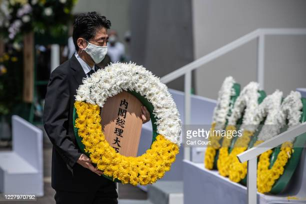 Japan's Prime Minister, Shinzo Abe, lays a wreath at the Peace Statue during the 75th anniversary of the Nagasaki atomic bombing, on August 9, 2020...