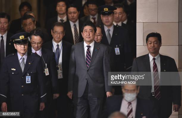 Japan's Prime Minister Shinzo Abe leaves after a budget committee morning session of the House of Representatives at the Diet in Tokyo on February 1...