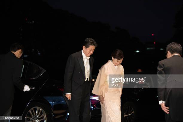 Japan's Prime Minister Shinzo Abe left and his wife Akie Abe arrive at the Imperial Palace for the Court Banquets after the Ceremony of the...