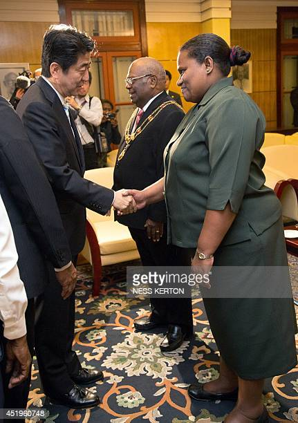 Japan's Prime Minister Shinzo Abe meets Papua New Guinea's GovernorGeneral Sir Michael Ogio and his wife Lady Ogio in Port Moresby on July 10 2014...