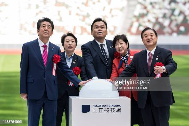 Japan's Prime Minister Shinzo Abe, Minister for the Tokyo Olympic and Paralympic Games Seiko Hashimoto, Minister of Land, Infrastructure, Transport...
