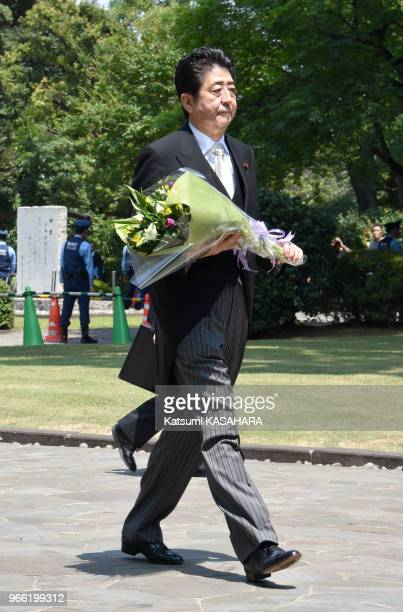 Japan's prime minister Shinzo Abe offers flowers at Chidorigafuchi War dead grave Land during the 70th anniversary of the end of World War II in...