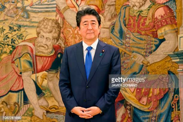 Japan's Prime Minister Shinzo Abe poses before his meeting with Spain´s King on October 16, 2018 at the Zarzuela Palace in Madrid.