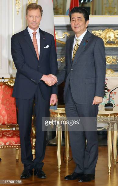 Japan's Prime Minister Shinzo Abe shakes hands with Grand Duke Henri of Luxembourg during a meeting in Tokyo on October 25 2019 / Japan OUT