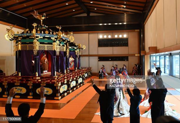 TOPSHOT Japan's Prime Minister Shinzo Abe shouts banzai cheer for Emperor Naruhito and Empress Masako during the enthronement ceremony where emperor...