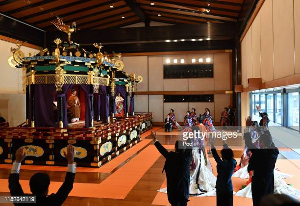 Japan's Prime Minister Shinzo Abe shouts banzai cheer for Emperor Naruhito and Empress Masako during the enthronement ceremony where emperor...