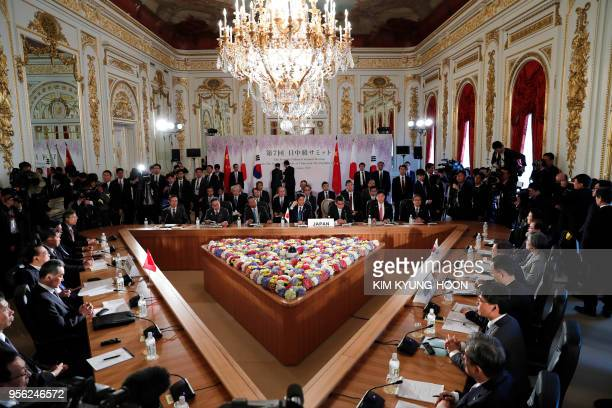 Japan's Prime Minister Shinzo Abe South Korea's President Moon Jaein Chinese Premier Li Keqiang and other delegates attend at a trilateral summit at...