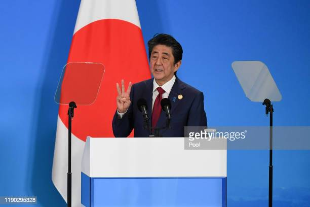 Japan's Prime Minister Shinzo Abe speaks at a joint press conference at the 8th trilateral leaders' meeting between China, South Korea and Japan in...