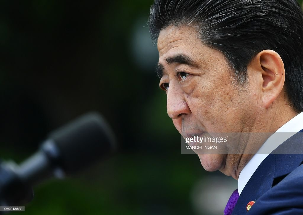 Japan's Prime Minister Shinzo Abe speaks during a a joint press conference with US President Donald Trump in the Rose Garden of the White House on June 7, 2018 in Washington, DC.