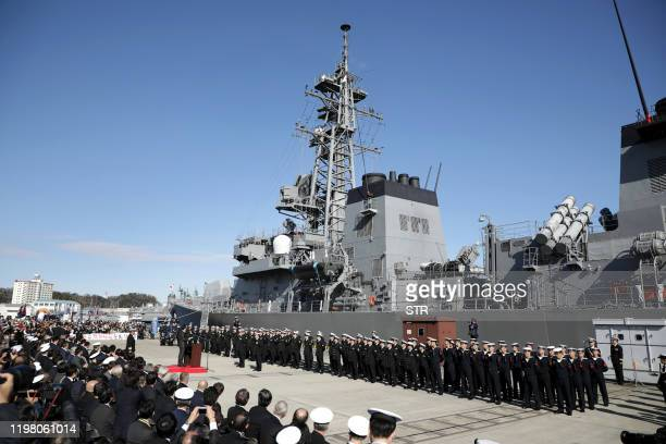 Japan's Prime Minister Shinzo Abe speaks during a ceremony to mark the departure of Japan's Maritime SelfDefence Force destroyer Takanami for the...