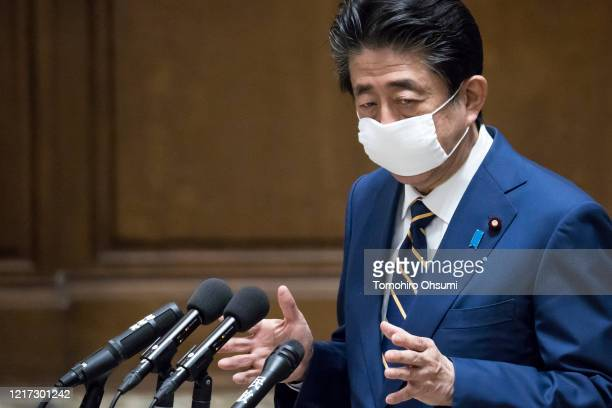 Japan's Prime Minister Shinzo Abe speaks during a committee at the lower house of parliament on April 07 2020 in Tokyo Japan Abe yesterday announced...