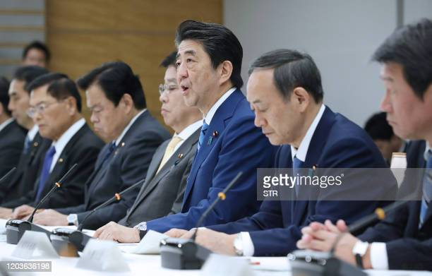 Japan's Prime Minister Shinzo Abe speaks during a meeting at the new COVID-19 coronavirus infectious disease control headquarters at the prime...