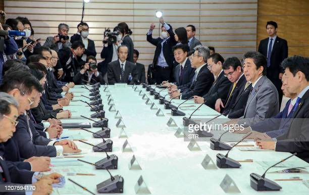 TOPSHOT Japan's Prime Minister Shinzo Abe speaks during a meeting of the headquarters for measures against for the COVID19 novel coronavirus at the...