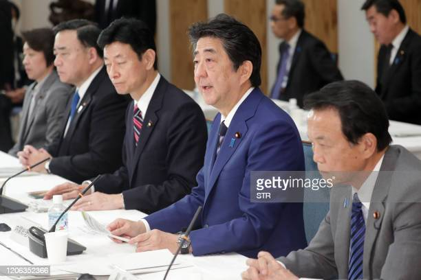 Japan's Prime Minister Shinzo Abe speaks during a meeting of the Council on Economic and Fiscal Policy at his office in Tokyo on March 10 2020...