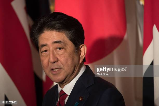 Japan's Prime Minister Shinzo Abe speaks during a press conference with Britain's Prime Minister Theresa May on August 31 2017 in Tokyo Japan Mrs May...