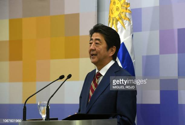 Japan's Prime Minister Shinzo Abe speaks next to Uruguay's President Tabare Vazquez during a press conference following a meeting at the presidential...