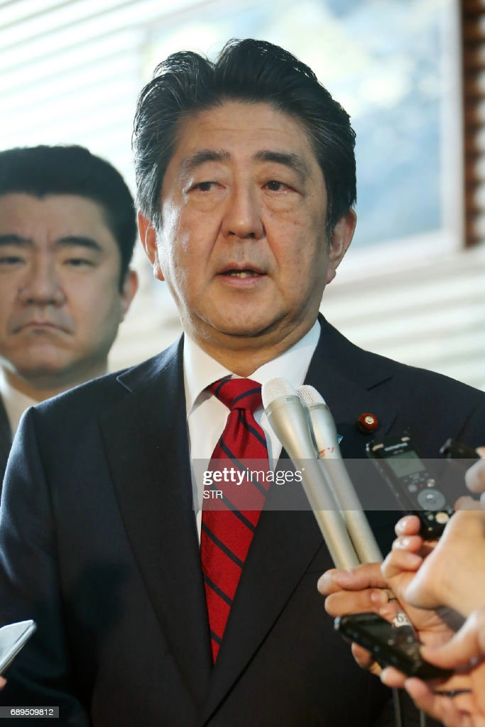 Japan's Prime Minister Shinzo Abe speaks to reporters at his official residence in Tokyo on May 29, 2017. North Korea on May 29 test-fired a ballistic missile, the latest in a series of launches that have ratcheted up tensions over its quest to develop weapons capable of hitting the United States. Abe swiftly condemned Monday's launch and vowed 'concrete action' with the US. / AFP PHOTO / JIJI PRESS / STR / Japan OUT