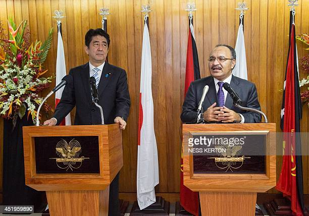 Japan's Prime Minister Shinzo Abe speaks with Papua New Guinea Prime Minister Peter O'Neil at a press conference in Port Moresby on July 10 2014 Abe...