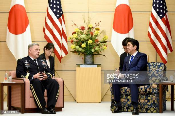 Japan's Prime Minister Shinzo Abe talks with Chief of Staff of the US Army Mark Alexander Milley during a courtesy call at Abe's official residence...