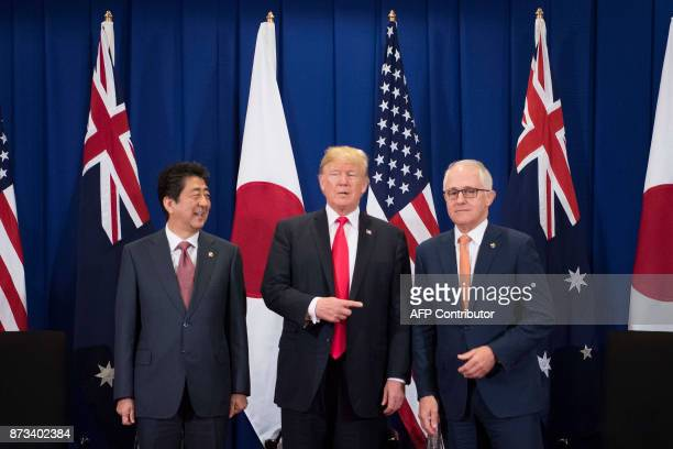 Japan's Prime Minister Shinzo Abe US President Donald Trump and Australia Prime Minister Malcolm Turnbull attend a trilateral meeeting during the...
