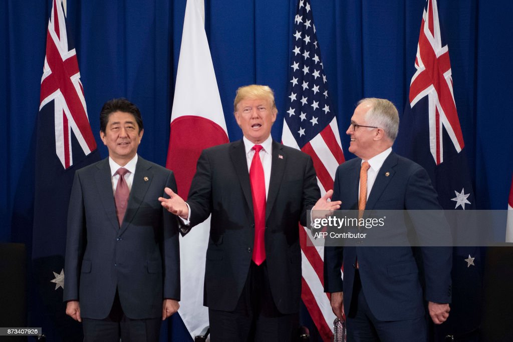 Japan's Prime Minister Shinzo Abe (L), US President Donald Trump (C) and Australia Prime Minister Malcolm Turnbull attend a trilateral meeeting during the opening ceremony of the 31st Association of South East Asian Nations (ASEAN) Summit in Manila on November 13, 2017. World leaders are in the Philippines' capital for two days of summits. /