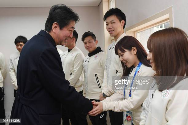 Japan's Prime Minister Shinzo Abe visits Japanese athletes in the Gangneung Olympic Village on February 10, 2018 in Pyeongchang-gun, South Korea.