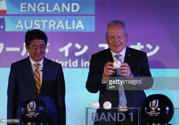 Japan's Prime Minister Shinzo Abe watches as Chairman of World Rugby Bill Beaumont draws England into Pool C during the Rugby World Cup 2019 pool...