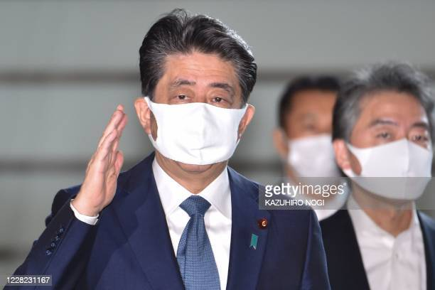 Japan's Prime Minister Shinzo Abe wearing a face mask arrives at the prime minister's office in Tokyo on August 28, 2020. - Abe is expected to hold a...