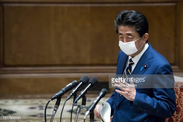 Japan's Prime Minister Shinzo Abe wearing a face mask speaks during a committee at the lower house of parliament on April 07 2020 in Tokyo Japan Abe...