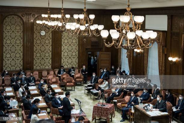 Japan's Prime Minister Shinzo Abe wearing a face mask speaks during a budget committee meeting at the lower house of parliament on April 28 2020 in...