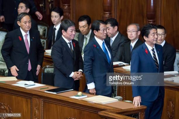 Japan's Prime Minister Shinzo Deputy Prime Minister and Finance Minister Taro Aso Foreign Minister Toshimitsu Motegi and Chief Cabinet Secretary...